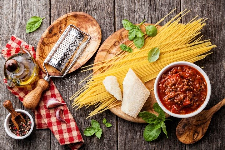 07 Dec 2014 --- Ingredients for spaghetti bolognese on gray wooden background --- Image by © Lisovskaya Natalia/The Picture Pantry/Corbis